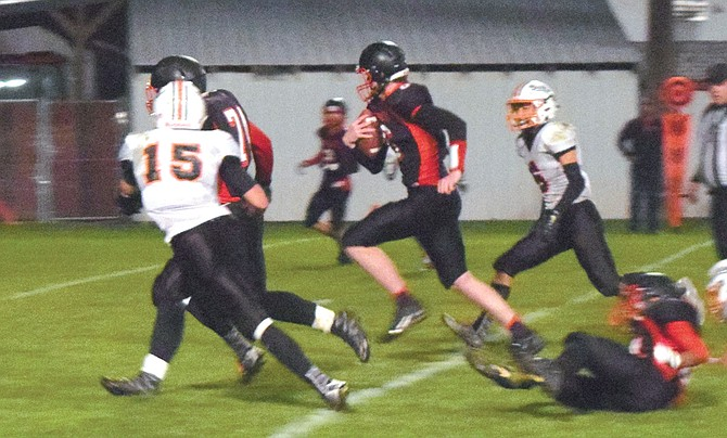 Omak quarterback Kanen Ables romps to touchdown against Cashmere during the Pioneers' homecoming game Oct. 6.
