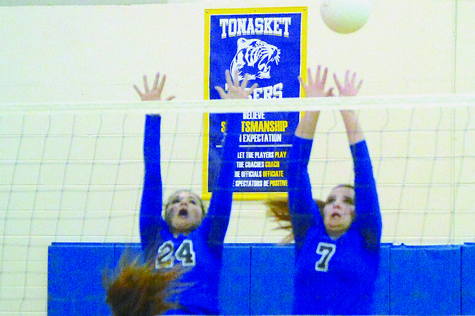 Tonasket's Maddy Clark and Taylon Pilkinton put up a block against Soap Lake on Oct. 3.