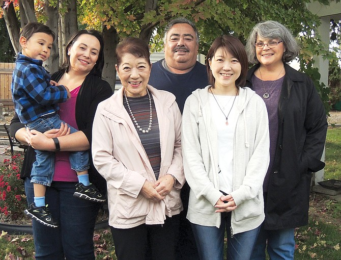 Yuko and Reiko Tsucamoto of Tokyo, Japan pose with Reiko's host family in 1994-95 during a foreign exchange student year in Sunnyside. One reason Reiko came back was to the extended host family. From right, the Escobars are Grandma Vicki, Grandpa Dave, daughter Gwen Abad and Grandson Michael Abad.