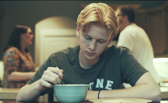 "Jacob Hamilton, who plays Alone in a suicide prevention video released at Central High School on Thursday, eats breakfast while his parents fight in the background. The video, titled ""Alone,"" was produced in coordination with the Mid-Valley Suicide Prevention Coalition and Talewind Visuals."