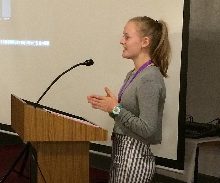 Eva Jones, president of the Hood River Valley High School Girl Up, addresses Columbia Gorge Women's Action Network members at a recent meeting to talk about the program.