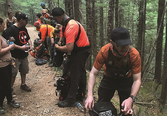 HIKER Emily Yan photographed rescuers bringing supplies to tired and thirsty trapped hikers Sept. 3.