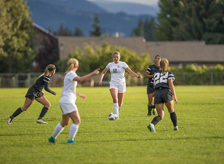 HRV Girl Soccer has scored a league high 20 goals in their past six games. Erin Sutherland (12) gets the cue from Makena Zorza to lead the ball up the field