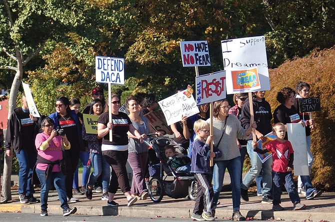 """Monmouth and Independence residents joined together to march for the rights of immigrants and those affected by Deferred Action for Childhood Arrivals.  Central High School students organized the event, which attracted more than 100 participants. The march showed support for DREAMers and urged Congress to pass """"a clean"""" Development, Relief, and Education for Alien Minors Act, according to organizers."""