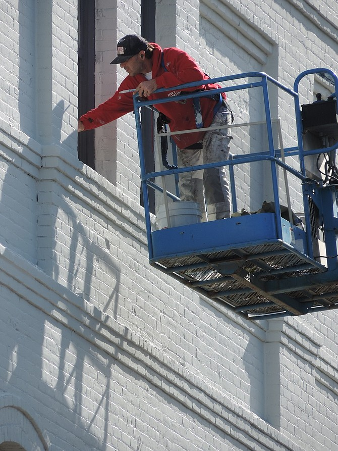 Historic Paris Fair Building over the past week has received a new coat of paint — Stonington grey, to be precise — with charcoal accents on the storefront, according to Claudia von Flotow of Key Development, which owns the building at Oak and Fourth streets.