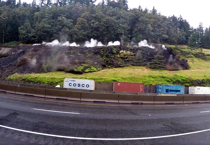 Dust flies during an Oct. 12 rock blast along Interstate 84 in this video still from Oregon Department of Transportation.