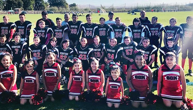 The 6-0 Sunnyside B-Black Grid Kid football team gathers for a photo last Saturday. The team will compete this Saturday at 11 a.m. on Sozo Sports Complex field 4. The Sunnyside A team competes on field 1 against Pasco at 3 p.m., Mabton A will be on field 1 at 1 p.m. against the Scouts. Sunnyside's C-Black plays at 1 p.m. on field 2, Grandview B team is on field 5 at 1 p.m. and Sunnyside B-Red is on field 5 at 3 p.m.  Sunnyside C-Red is on field 3 at 1 p.m. and Mabton C team is on that field at 3 p.m. The games on fields 1, 2 and 4 are playoffs.