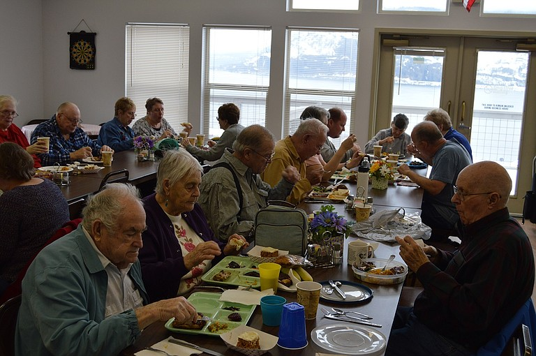 Community gathers for a meal at the Mosier Senior Center last winter. The center hosts a craft fair Oct. 28, featuring handmade items.