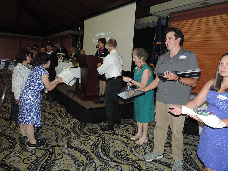 Tsuruta board members pass out gifts to guests at the 40th anniversary celebration of the sister city program in July.