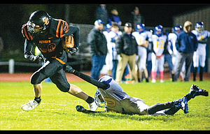 Sherman senior Bradley Moe breaks away from an Arlington-Condon tackler in the first half of Friday's Big Sky Conference game played on senior night in Moro. Moe rushed for 107 yards and a score, as the No. 12 Huskies led 46-0 at the half in a 46-8 victory.