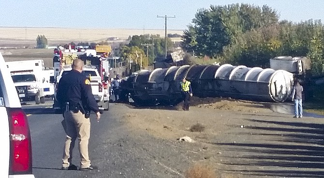 One man died Monday when his tractor-trailer overturned on SLI Road, northeast of Sunnyside.