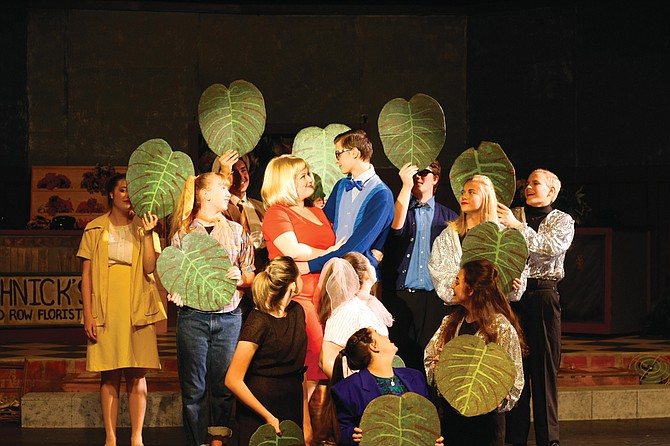 "The cast of ""Little Shop of Horrors"" surrounds Seymour and Audrey during rehearsal on Friday afternoon."