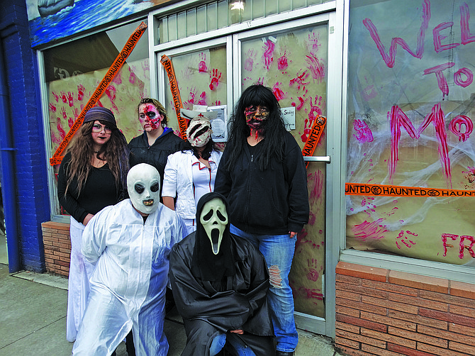 """Mellissa Hoover, right, and her cast of  """"scarers"""" and ready to terrify you for a cause."""