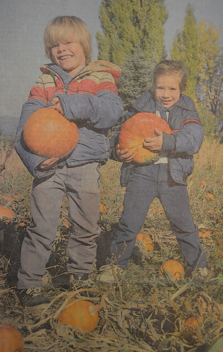 October 28, 1987 — Many local schools have visited Rasmussen Farms' pumpkin patch recently, as children get ready for Halloween this Saturday. Above, from left, Marcos Lamas and Lupe Contreras attend Pine Grove Head Start; they gathered their pumpkins Oct. 15 with their classmates from Pine Grove. (The school is part of Mid-Columbia Head Start, which is celebrating its 20th anniversary this year. October is also National Head Start Month.)