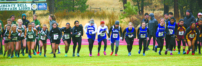 Girls start their 5K race at the league championships Oct. 21 at Liberty Bell High School.