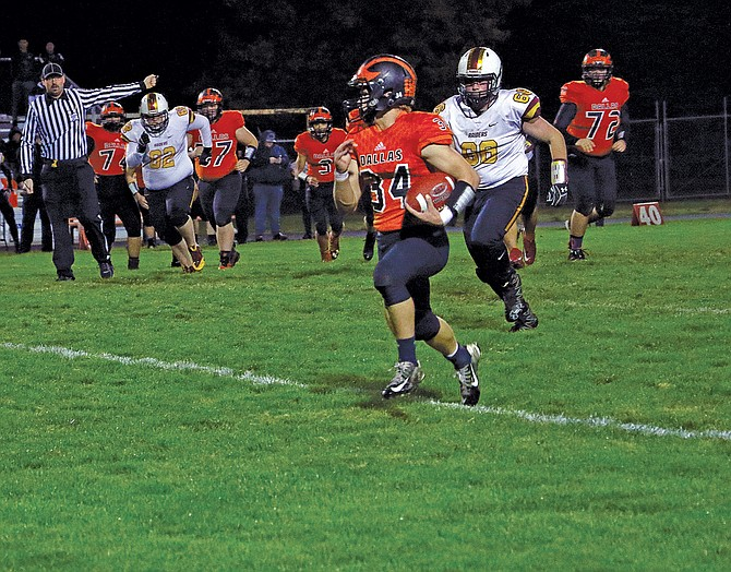 Dallas running back Brycen Grillo runs against Crescent Valley during the Dragons' 31-21 loss on Friday.