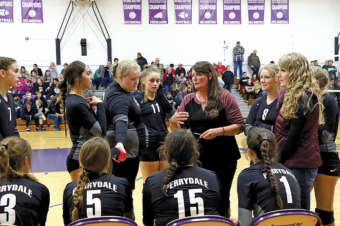 Coach Denise Dickey talks with her team during the Pirates' match on Saturday.