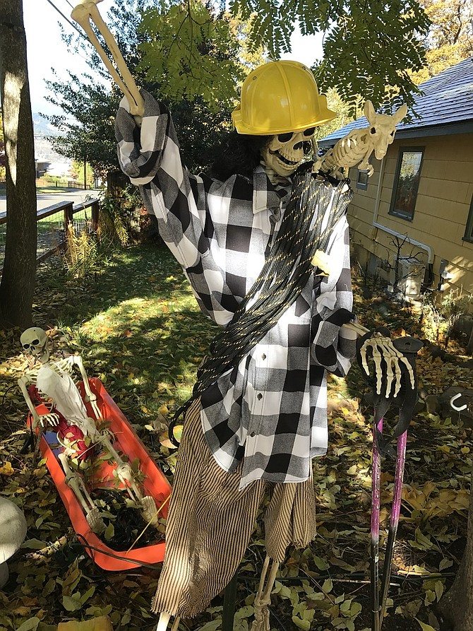 HOMEOWNERS are preparing for Halloween with creepy trappings in the trees, fences and yards, including this testament to first responders (in this case, Crag Rats) at the Heights home of Steve and Rosemary Shepardson.