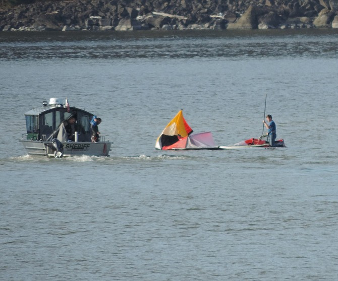 SEEN from Event Site beach, Hood River County deputies Joe Wampler, at wheel, and Kyle Cozad, help kiter Bill Lane collect his gear with help from a paddler, identified only as Sean, who heard Lane's cry for help.
