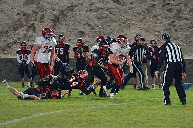 Julian Cates of Okanogan leaves behind Omak tacklers en route to the eight-yard line that set up a score by Martin Grooms in a 41-7 win over the Pioneers on Oct. 26.
