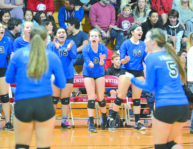 The Tonasket volleyball bench cheers for a point during match at Brewster on Oct. 24.