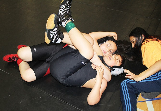 Little Grapplers' James Perez cradles Quincy's Michael Vazquez to score near fall points at a tournament last March in Mattawa.