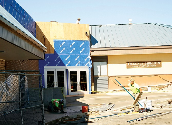 Workers finish the new entrance to Oakdale Heights Elementary School. The improvements were paid for with bond proceeds.