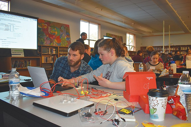 Innovate Oregon make-a-thons are open to students of all ages and adults who want to participate. During the events, teams work together to use newly learned coding skills to solve problems.
