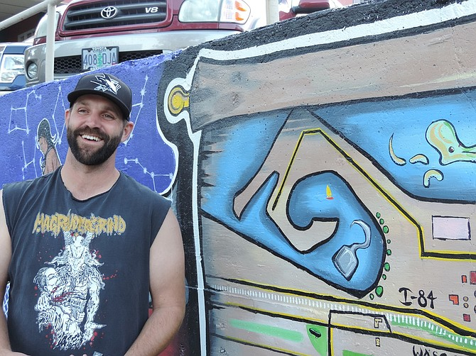 """WALK one block over from the Center for the Arts and check out Nik Vik's big project, """"The Remains mural."""" Vik, who speaks Thursday at """"Rooted"""" at the center, has nearly completed the mural, which he started in May with his Remains gallery co-founder, the late Nate Chavez."""