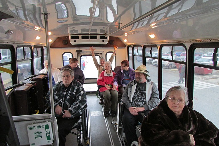 North Valley Extended Care residents and community members board a new bus en route to Loomis, Wednesday, Nov. 1.