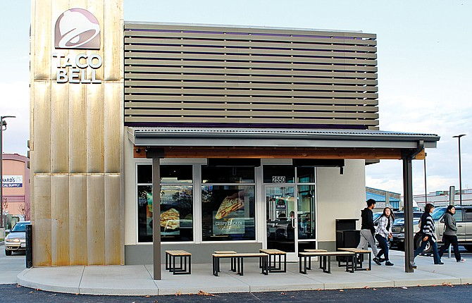 The exterior of the new Taco Bell has a slight rustic look and while the dining room is about the same size, the kitchen and storage are much larger.