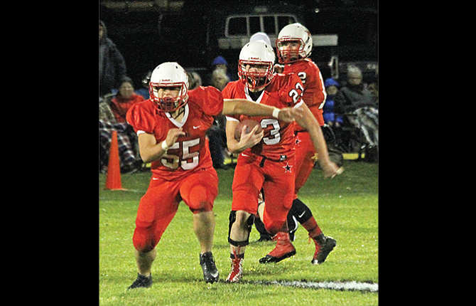 Dufur Ranger running back Hagen Pence, middle, follows the lead block of teammate Ian Cleveland during a 1A football game played earlier this season. The No. 2-ranked and undefeated Rangers kick off state playoff action starting at 6 p.m. on Friday night at home against the No. 15 Lowell Red Devils.