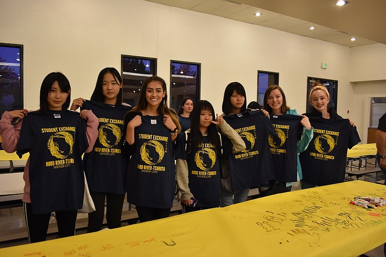 Above, host students and Tsuruta students show off their exchange t-shirts given to them at the welcome dinner last Saturday; from left to right, Sakura Kudo, Rinka Kida, Jordan Ziegner, Miku Nakamura, Erika Takahashi, Jaela Turley and Noel Sims.