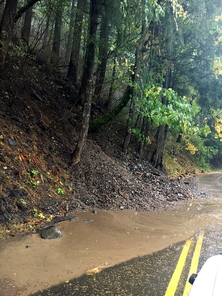 A MUDSLIDE spreads across a lane of Highway 30 east of Multnomah Falls in late October. Authorities urge the public to stay out of the Eagle Creek fire area, which hazards have made dangerous.