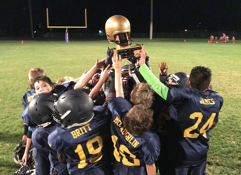 Hood River Gold youth tackle football ended their season with an undefeated record and went on to win the Golden Helmet Trophy last Saturday after beating White Salmon 34-0 in the championship.