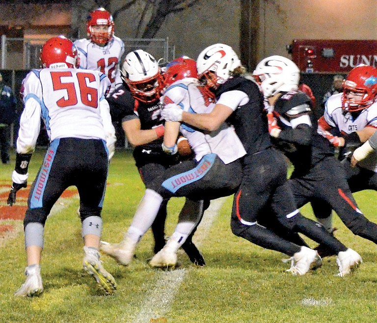 Grizzlies defenders Justin Reyes and Andrew Gallagher wrap up Eastmont's Devon Schneider for a safety denied the Grizzlies Friday.