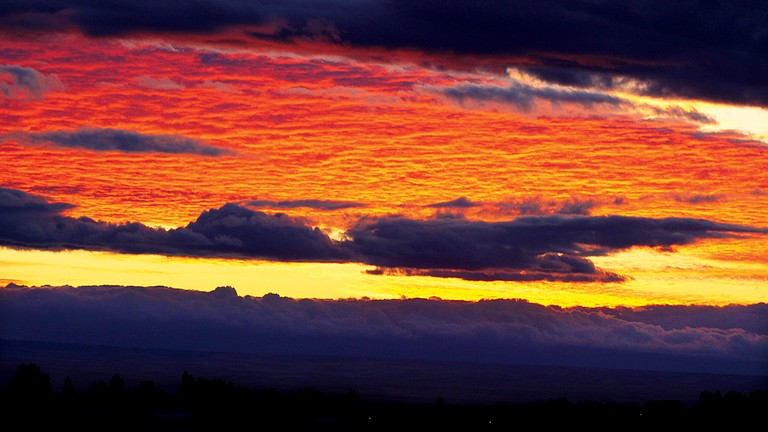 A colorful sunset filled the sky over the Lower Yakima Valley last Thursday night before a cold front set in, bringing mostly rain, but some snow to the Prosser area. The forecast is for clearer skies today and tomorrow, before another winter storm moves into the area on Wednesday.