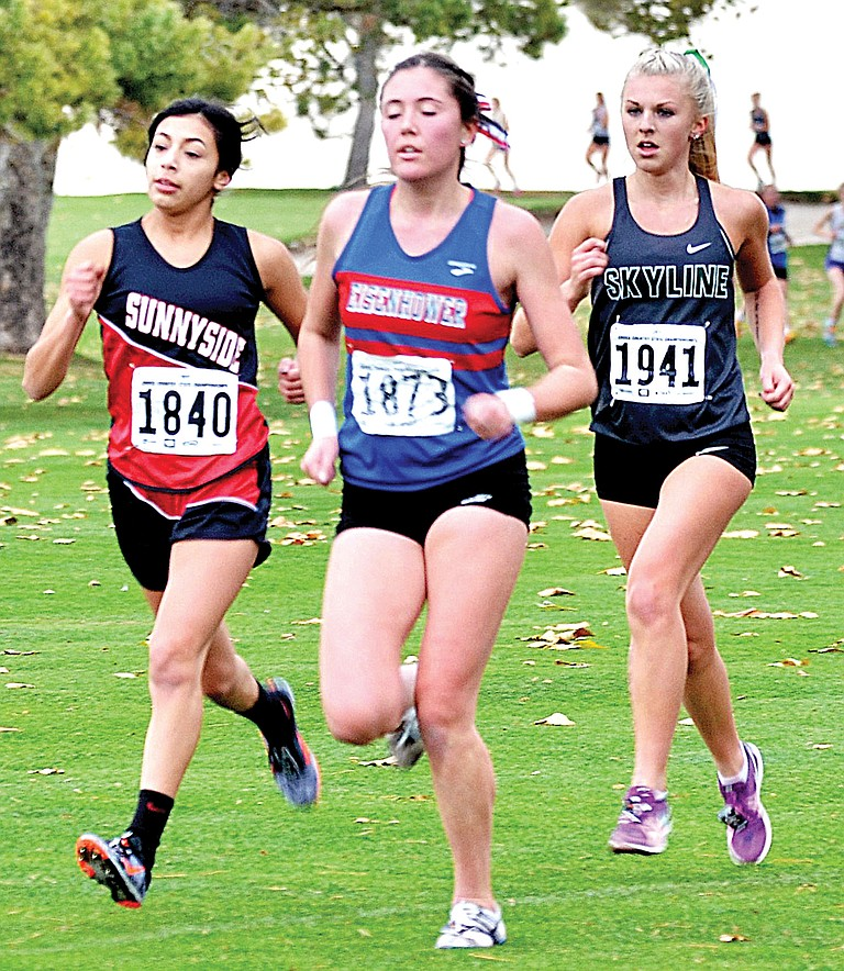 Sunnyside's Dallas Borrego was among the Lower Yakima Valley runners in the state cross country meet Saturday in Pasco. Pictured, she trails Eisenhower's Molly Stephenson but lead's Skyline's Amber McGraw during the girls 4A race. Full coverage will be published in the Tuesday edition of The Daily Sun.
