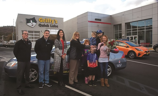 WHEELS of Hope keys are presented by Griffith General Manager Tammy McVane to Patrese Evans, far right, at the dealership in The Dalles. Left to right are Bill Nielsen, Randy Haines and Tammy Dirks with Bicoastal Media; McVane, and the Evans family, including Patrese Evans, Ryhin Evans, Trinity Evans, Cory Judson and Emery Judson.
