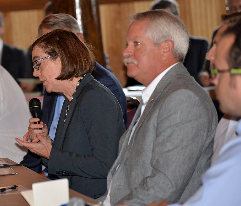 MARK JOHNSON listens along with Oregon Gov. Kate Brown at an economic development meeting last month in Cascade Locks.