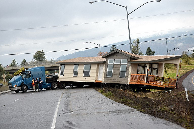 A commercial semi-truck hauling a manufactured home crashed Monday morning, blocking Interstate 84 westbound just before exit 63 for about 90 minutes. The driver, a Hermiston man, was sent to the hospital with minor injuries.