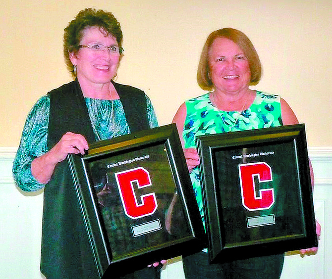 Omak graduates Jan (Harriman) Schuerman (left) and Nellie (Field) Kirk were presented with varsity letters by Central Washington University on Oct. 28.