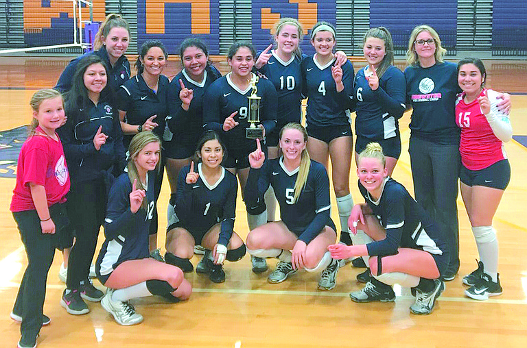 The Brewster High School volleyball team celebrates in a vacant gym its winning the District 5/6 title around 11 p.m. Saturday at Wenatchee High School.