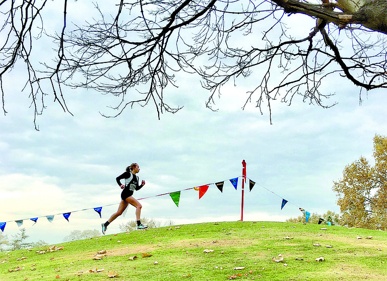 Evangeline Lamb of Omak heads up a final hill alone about a quarter mile from the finish line at state 1A cross country Nov. 4 in Pasco.