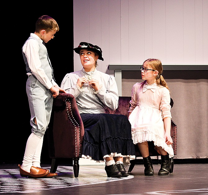 """Comforting the Banks children after a disastrous encounter with a bad nanny, is Mary Poppins (played by Kayla Bos) in the Sunnyside High School Drama Department presentation of """"Mary Poppins."""" The musical opens at 7 p.m. Friday on the auditorium stage, 1801 E. Edison Ave. Elijah Wise plays Michael Banks and Emily Johnson portrays Jane Banks. Saturday performances are at 2 p.m. and 7 p.m. The play will also be staged at 7 p.m. Nov. 16, 17 and 18."""
