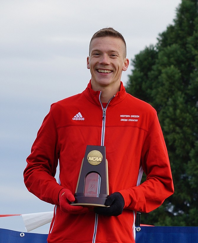 Western Oregon University cross-country runner David Ribich celebrates after taking first at the NCAA Division II West Region race on Saturday morning.