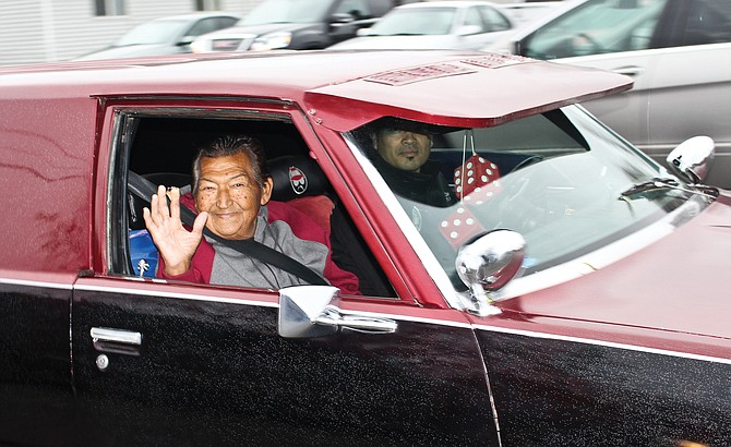 """The smile says it all as Sunnyside resident Ramiro Almaguer takes a ride, maybe his last, in his """"Baby"""", a 1978 Chevy custom station wagon Wednesday."""