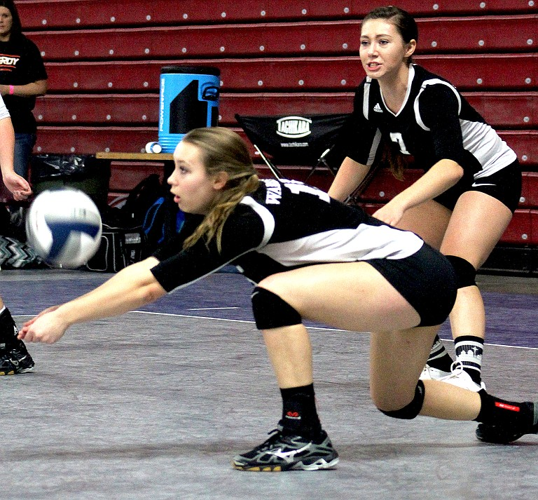 An Almira/Coulee-Hartline player digs out the volleyball at the state 1B tournament in Yakima's SunDome.
