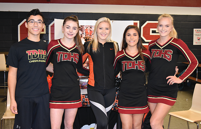 The Dalles High School cheer members, pictured from left to right, Nathan Nañez, Emily Adams, Jessika Nañez and Kendyl Kumm are joined by 2016 TD graduate and current Oregon State University Dance Team captain Taylor Sugg, in middle, at Saturday's Oregon Cheerleading Coaches Association competition held at Thurston High School in Springfield. Jessika Nañez was one of 12 cheerleaders, out of more than 30, to earn a spot on the all-state squad.