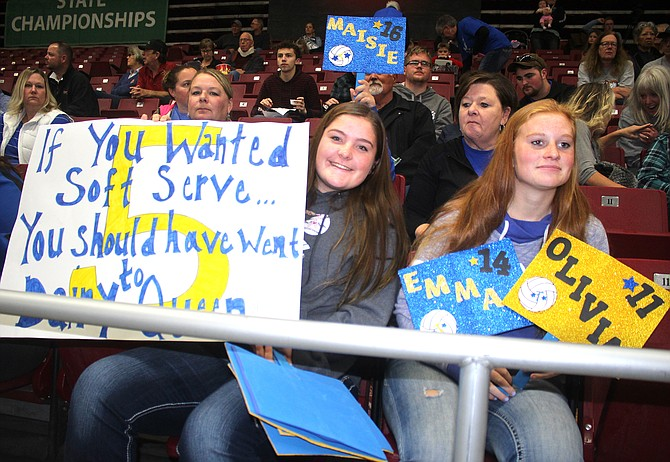 Tonasket fans Grace Cody, left, and Madi Larson show their support at the state 2B volleyball tournament at the Yakima SunDome.